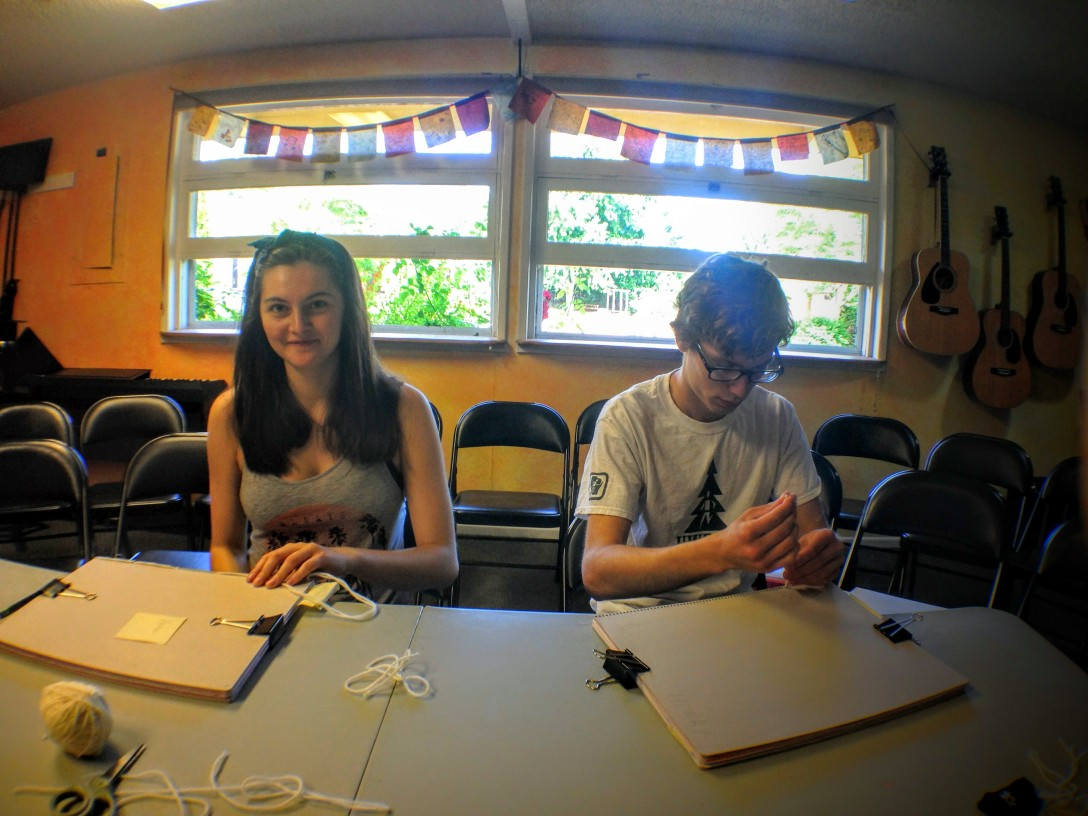 book binding with Maddy and Caleb