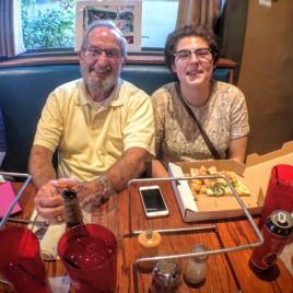 Katie and her bonus Grampa eating pizza.